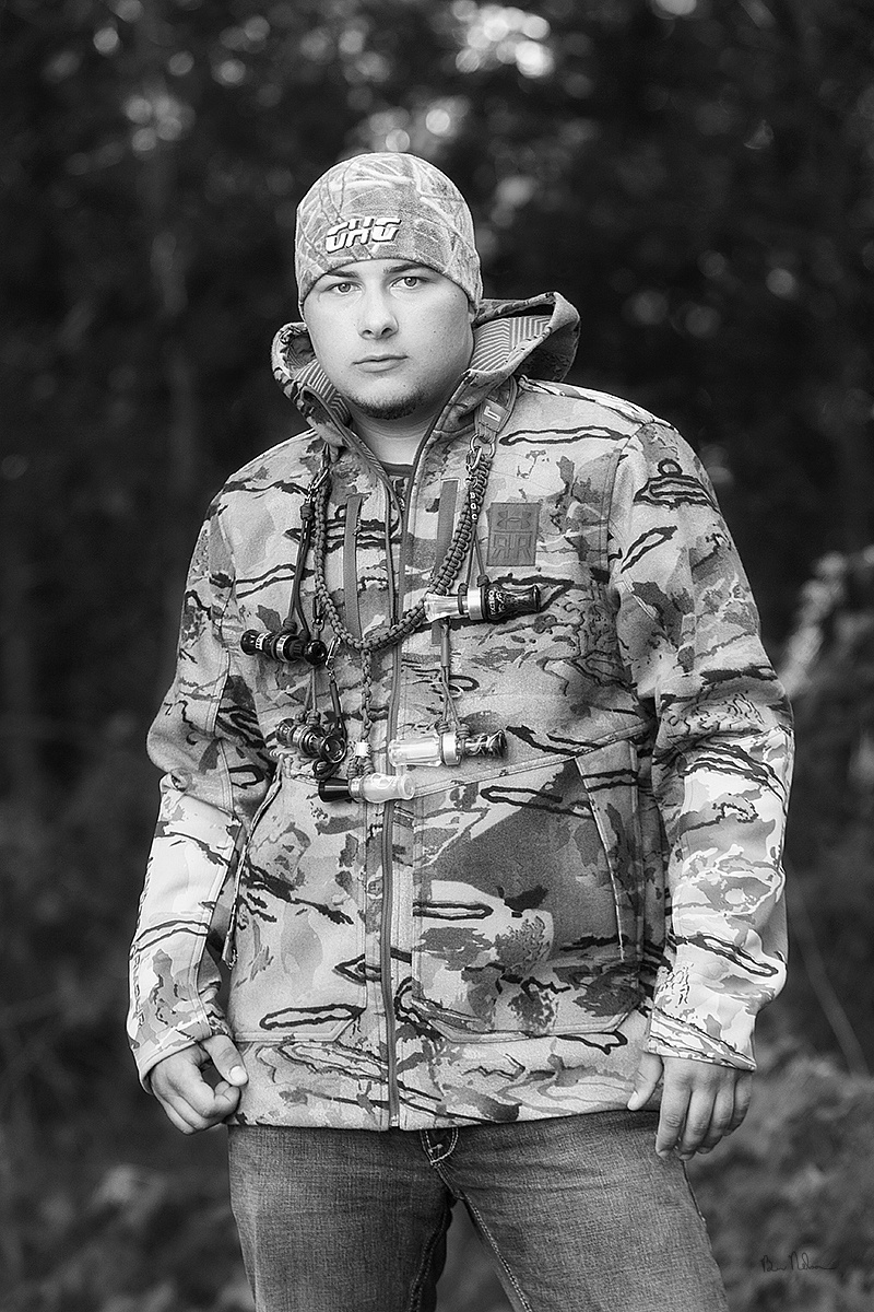A collection of Senior Pictures and Portraits in the Springfield Missouri area by Ben Nelson - Cory Cumley senior portrait with camo.
